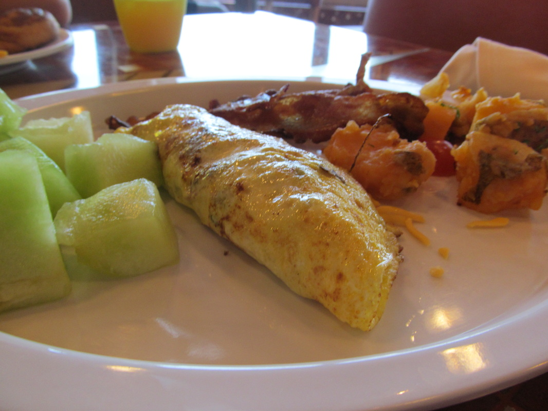 Fruit, Omelet, Bacon, and Potatoes