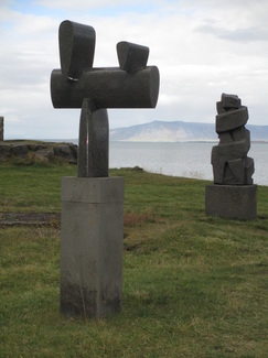 Sculptures in front of art museum on the shoreline path