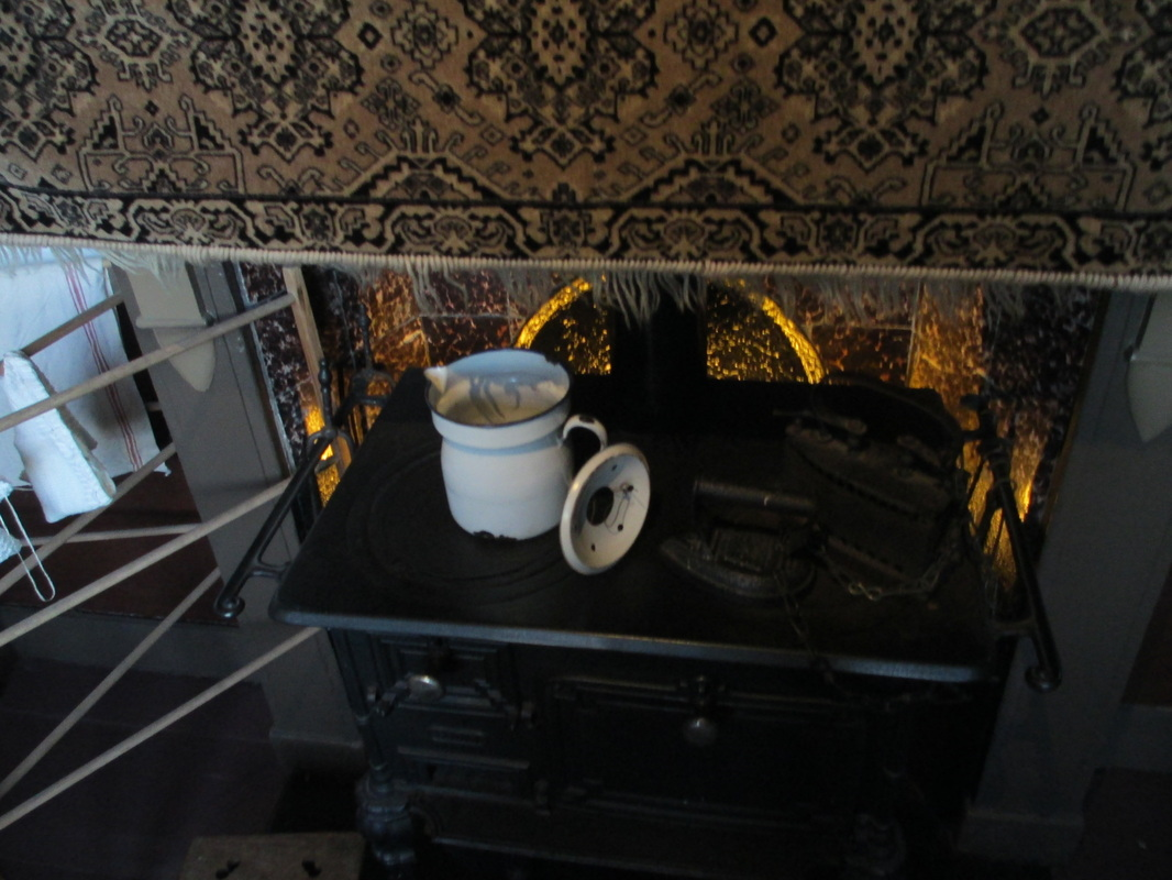 Iron stove in hallway, no actual kitchen