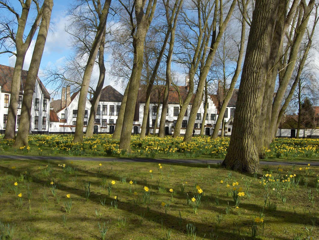 Beguinage - courtyard with small dwellings used by a group of religious women who serve God