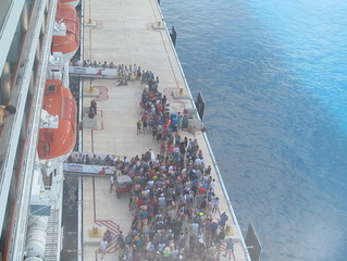 Late Passengers Getting Back on the Carnival Triumph