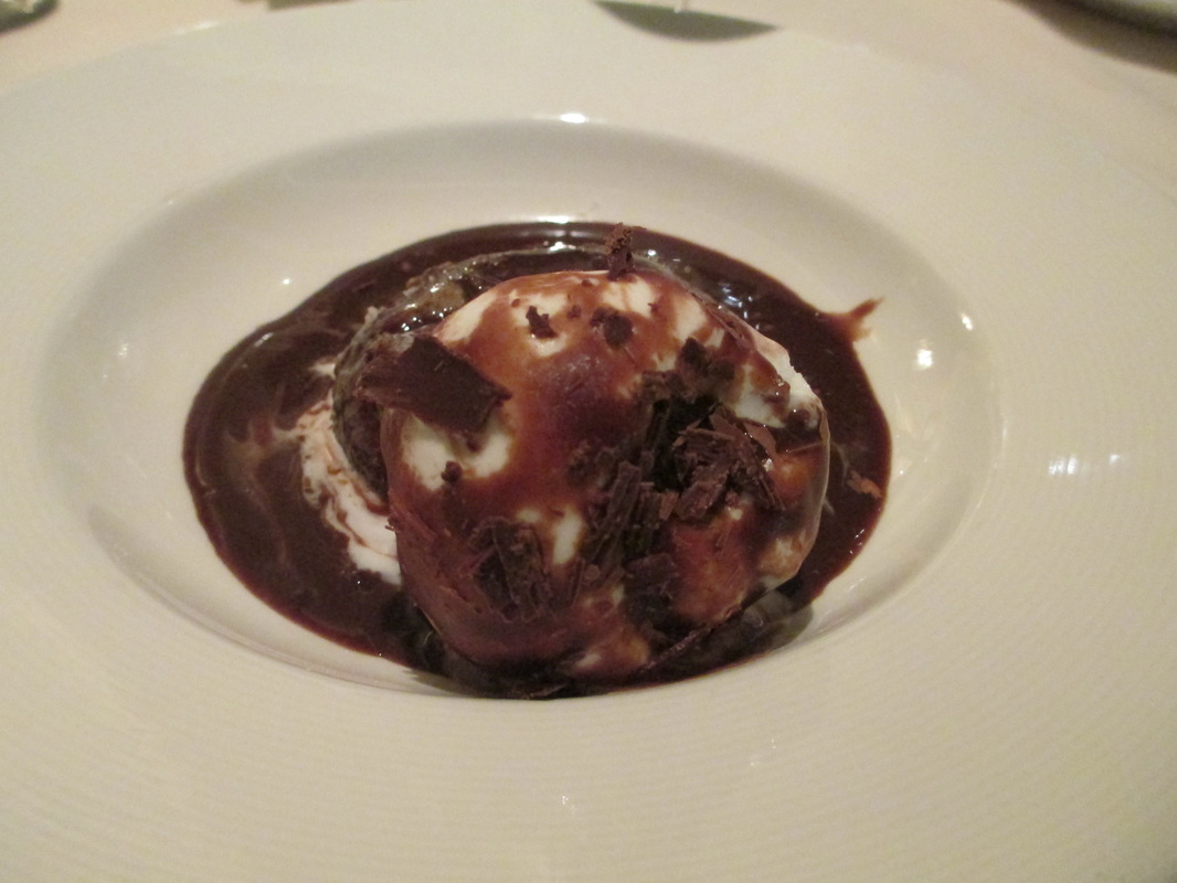 Special chocolate cake with ice cream and chocolate sauce