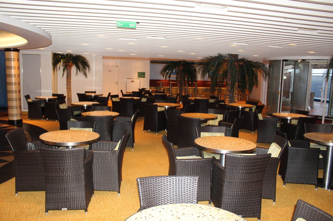 Carnival Vista Ocean Plaza Tables and Chairs