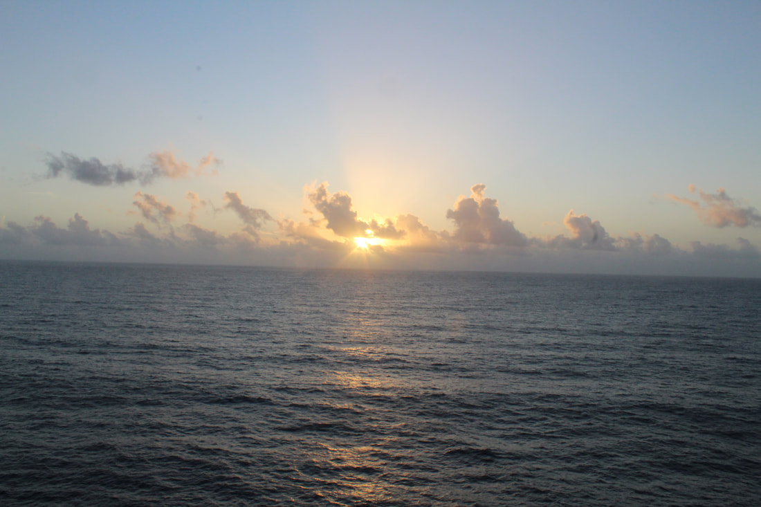 View Of Sunrise From Carnival Dream